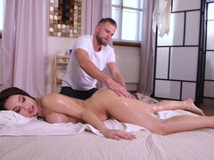 Dude gives busty brunette a massage and a fuck
