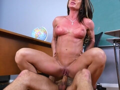 Muscular teacher Nina Dolci gets fucked by student