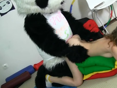 A guy in a panda suit is penetrating a curly teen slut