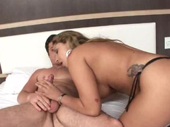 A blonde that has a immaculate rack is getting laid in the bed