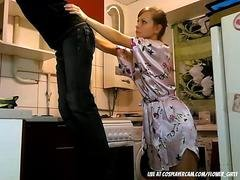 Beautiful housewife playing with her electrician on cam