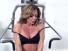 A kitten with large tits is in the gym, getting her booty rammed