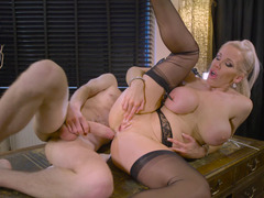 A blonde pushes her bra buddies together for a jug fuck in the video