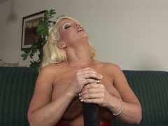 A enormous sextoy is getting shoved inside a hot blonde with sizeable breasts