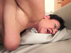 A huge dude is pushing his dick into a horny old fat woman