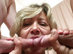 Grown-up woman takes a pair of dicks from both sides