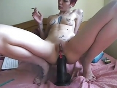 camgirl play with a large dong
