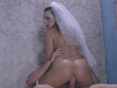 A sexy blonde in a wedding dress is getting penetrated by a man