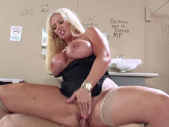 A blonde performs a blow job in the toilet in the school