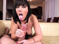 A whore that loves sucking dick is giving a blow job to her man