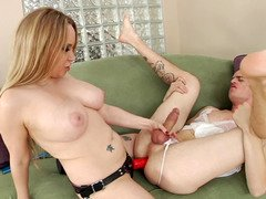 A blonde with huge tits is fucking her boyfriend by her huge toy