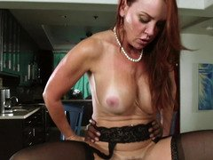 A redhead that has a sexy butt is getting her pussy lips licked