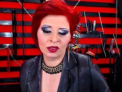 Erotically attractive Red Head Dominatrix Soccer mom Smoking On Cam In Boots