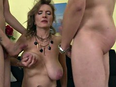 Adorable old mom cum covered by a pair of sons