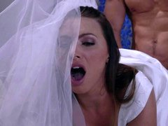 A sexy blonde in a wedding dress is getting penetrated by a lad