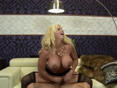 A blonde with melons penetrates her lover by a strap on