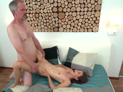A hot slut with small tits if fucked by a mature guy with gray hair