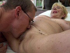 A porky granny unclothes by the pool and besides she gets fucked there