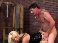 A sexy mistress spanks her large muscular lover in the dunger