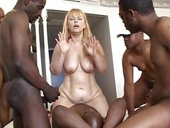 Group of men bangs a brave woman together
