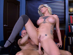 A boobalicious slut is getting penetrated in the office by the dean