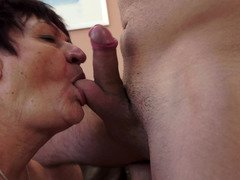 Brown haired granny with huge natural boobies gets a huge meat pole