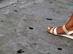 Candid ebony feet at the bus stop