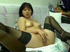 old onlineweb chat Maya in shoes intently fingering her vag