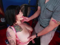 Tattooed broad with large boobs is having loads of fun with a hot load