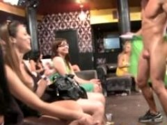Clothed cuties give oral sex