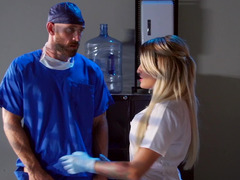 A blonde is in the hospital, having fun with the doctor on the table