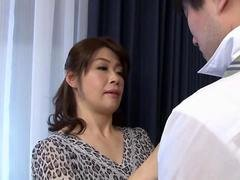 Bigtitted Japanese cougar fondles her bushy jelly roll on couch