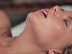 A sexy kitten with undersized breasts is on the bed, teasing her tight muff