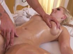 Oiled blonde gets doggy from masseur
