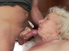 Fat old granny is getting her soggy cunt fucked really hard