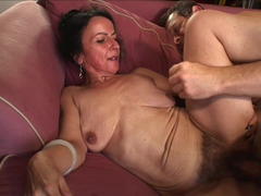 A granny with saggy boobs is getting penetrated deeply in this vid