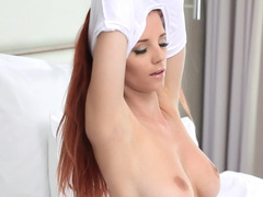 A redhead slowly takes off her clothes and she touches her snatch