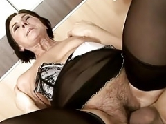 Unshaved granny In Stockings Pleased Her Young-looking Lover