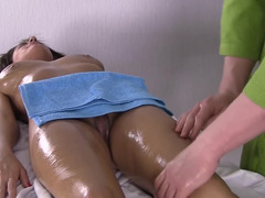 Two big jugs are getting groped and massaged on the massage table
