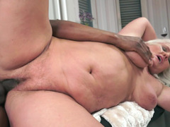 A granny gets her sizeable saggy tits groped by a sizeable black lad