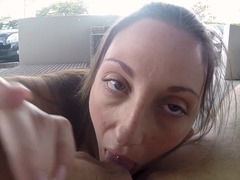 A brunette amateur is handling a cock in front of the camera