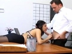 Sinful secretary in ripped pantyhose banging on her bosses desk