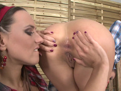 Two kinky cowgirl are discovering how to use large dildos