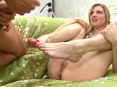 Blonde is using her sexy legs on the men huge hard cock to get him off