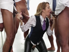 Jessica Drake sucks three big dicks in sexy leather pants