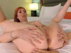 Redhead with hot tattoos is getting her pussy fingered well