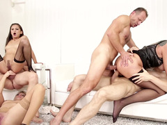 Broads are doing an orgy with some fellas at a swingers party