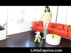 Little Caprice rides a red vibrator