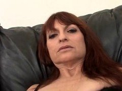Aged redhead gives solo getting down and dirty show