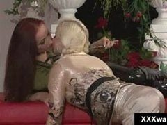 Blonde hoe swims fully clothed while her redhead gir